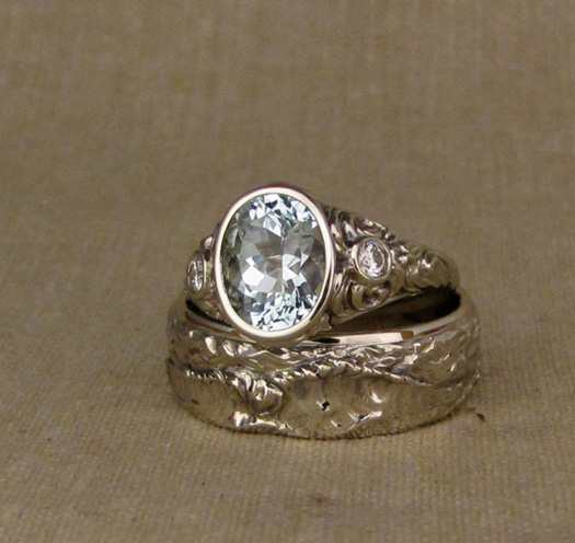 Custom-designed & hand-carved Aquamarine Open-Bezel Solitaire with splashing water/waves motif. + Ocean Waves wedding band. 14K white gold