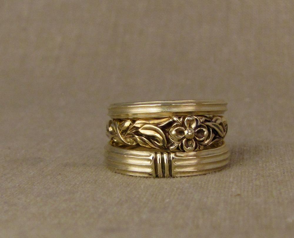 Custom designed and hand-carved wedding set. Architectural fluted column and botanical elements motif. 14K gold.