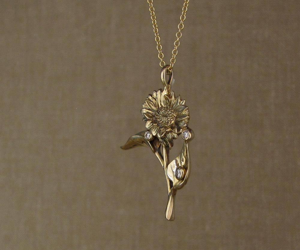 Custom-designed & hand-carved Sunflower pendant with diamonds, 14K yellow gold.