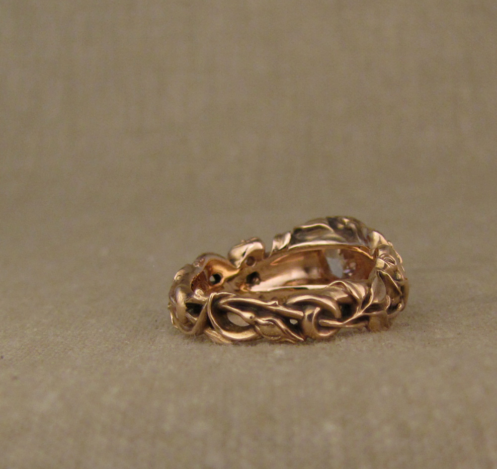 Custom designed & hand-carved Pink diamond solitaire set in quatrefoil setting with snakes and roses, 14K rose gold