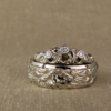 ocean water + waves motif wedding bands