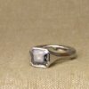 custom emerald-cut geometric solitaire