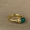 emerald cabochon solitaire