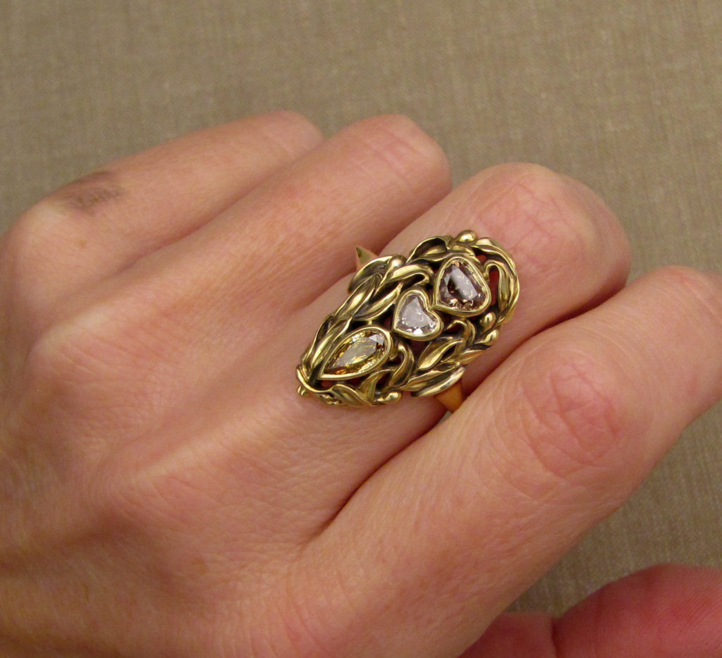18K hand-carved olive branch navette ring, set with fancy colored+cut diamonds